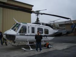 Attorney near a helicopter.